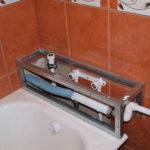 как закрыть трубы в ванной
